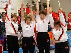 Canada's women's curling team (from left to right) Jan Betker, Marcia Gudereit, Joan McCusker and Sandra Schmirler cheer at the 1998 Nagano Winter Olympics. (CP PHOTO/COA/Mike Ridewood)