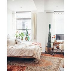 Eclectic shared workspace/bedroom with layered rugs #workspacegoals