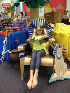 Student at book fair. Egyptian cat made from foam board using acrylic paints.