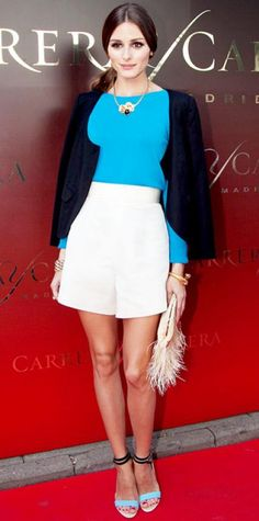 JUNE 23, 2012  WHAT SHE WORE The stylish star opened the Moscow International Film Festival in a bright top and white shorts from Katie Ermilio, topped with a vintage blazer and accessorized with gold jewelry, a plumed clutch and strappy Tibi sandals. WHY WE LOVE IT The girl knows how to accessorize! Olivia Palermo amped up her ensemble with eclectic extras