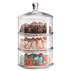 Stackable three-tiered canister with lid.  Product: CanisterConstruction Material: GlassColor: Clear