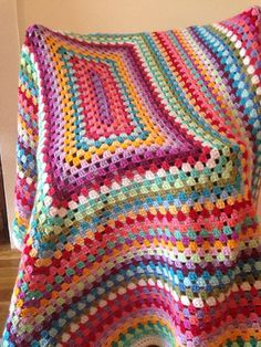 Crochet blanket - love the colors - Great idea for all leftover yarn - notice this was started as a rectangle. More