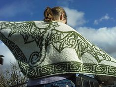 This double knit shawl features the motif of a stunning Celtic Wind Dragon with wings made from triangular Celtic knots.
