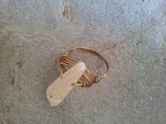 Shell golden wire wrapped ring.