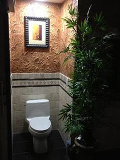 Tiled toilet area with textured wall
