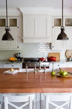 Subway tile, butcher block, lights...what's not to love!
