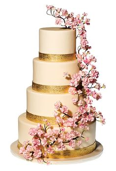 Brides.com: The Most Creative Wedding Cakes of the Year. Ana Parzych Cakes, New York, NY. Cherry blossoms are wildly popular for spring weddings, and these hand-wired gum-paste blooms are beautiful with the gold trim.  Cream-colored wedding cake with gum-paste flowers and gold bands, $15 per slice (serves 200), Ana Parzych Cakes  See more cakes for a spring wedding.