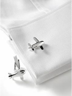 Airplane cuff links from Banana Republic. They were a Christmas gift for Isaiah. He really likes them, because they're airplanes. And he loves to fly airplanes.