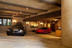 Masculine finished garage with exposed wood beams and tiled floors...