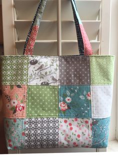 A personal favorite from my Etsy shop https://www.etsy.com/listing/590377776/quilted-tote-bag-handmade-quilting-tote
