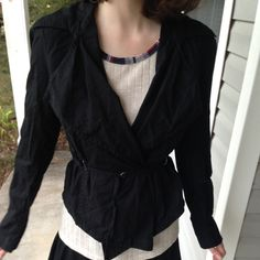 """Belted Black Jacket Amazing black jacket with a built-in belt and a cool crossover effect. I used to call it my """"vampire slayer jacket"""" because it gave me a Buffy vibe! It's pre-loved but still in excellent condition and has a lot of life left. It's too snug on me now, so hopefully I can find it a new home so it can make someone else feel cute and powerful like it did me! Converse Jackets & Coats"""