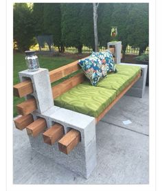 Bench made with cinderblocks and landscape timbers. Hold blocks together with cement glue. Great for around the fire pit!