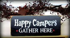 """This wood camp sign is made from pine, and measures Approx x It reads """"Happy Campers Gather Here"""". The front is painted Black then distressed, the back is stained . We've used a piece of jute for hanging. Makes a great gift for the camper or hunter."""