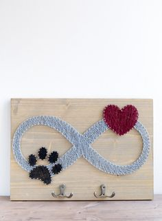 Infinity sign dog leash holder for animal lovers with paw and heart design.