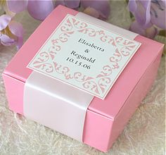 """pink 4-pc. ballotin favor box with a 1.5 """" wide snow white satin ribbon band and a medium square, white regal gift tag with a light pink col..."""