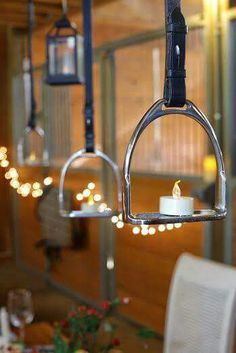 Horse stirrups as candle holders. What a great idea for horse lovers for a wedding or special event. A Moveable Feast – An Equestrian Thanksgiving Equestrian Decor, Western Decor, Equestrian Style, A Moveable Feast, Horseshoe Crafts, Horseshoe Jewelry, Horseshoe Ideas, Horse Jewelry, Thanksgiving Traditions