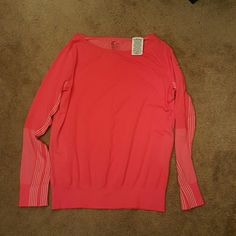 Nike Drifit Longsleeve top Size medium Long sleeve Nike Drifit top. The top has a vented back and sleeves. Perfect for a run.  Dark Coral in color. Worn once. Free of stains and blemishes. No trades. Nike Tops