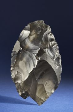 Happisburgh Handaxe. Unknown maker, Lower Palaeolithic, c. 700,000 BC. Flint; 12.8 x 7.9 x 3.7 cm. Norfolk Museums & Archaeology Service, Norwich Castle Museum & Art Gallery.