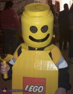 Lego Costume made from cardboard box with yellow duck tape, and a cheeseball container!  Super cute!