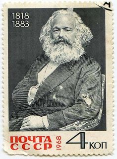 Karl Marx gettin' his Napoleon complex on in a great commemorative Soviet stamp from Love the holes in his frockcoat, and even the worn-out arm of the chair he's in.