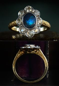 1920s Art Deco Black Opal and European Cut Diamond Ring, Platinum, 18K, $2150 This opal is almost completely opaque; the color of the night sky. But at the right angle it flashes with electric blue...