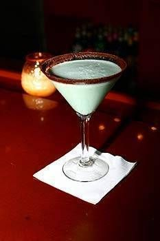 Dirty Girl Scout Martini  7 oz. martini glass lined garnished with Nestle Quick Chocolate Powder 2 1/2 oz. equal parts of Godiva White Chocolate and Dark Chocolate Liqueurs 1 1/2 oz. Smirnoff Twist Vanilla Vodka 1/2 oz. Dark Green Cream de Mint Splash of cream, shake and strain into a martini glass