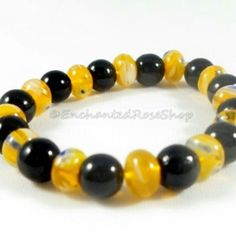 Love baby bracelets?  Black glass  and yellow millefiori beaded bracelet.  #babybracelet #newbornbracelets #babyshower #babyjewelry #newbornjewelry #enchantedroseshop #pottiteam