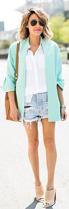 Christine Andrew is wearing a white Chico shirt, an Ellen Tracy teal blazer and a pair of light wash distressed shorts
