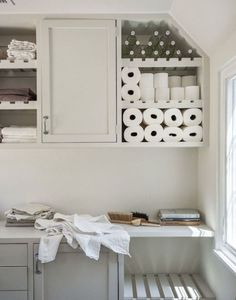 cool to have some shelves with slatted bottoms. bathrooms - laundry room shelving, laundry room, laundry room storage, Laundry room with open shelving over cabinets topped with white countertops. Laundry Room Shelves, Laundry Room Design, Laundry In Bathroom, Laundry Baskets, Laundry Rooms, Garage Laundry, Organized Bathroom, Small Laundry, Amanda Pays
