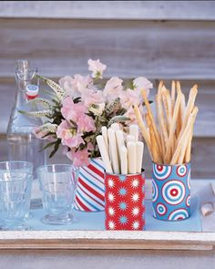 4th of July picnic.....scrapbook paper on tin can.....use for breadsticks....flowers....silverware.......etc.....