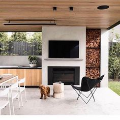 The perfect outdoor entertaining space. and I'll take one of the cute puppy too please 🐶 Brighton 5 by Styling… House Design, House, Outdoor Entertaining Area, Home, Outdoor Entertaining Spaces, Outdoor Kitchen Design, New Homes, Outdoor Fireplace, Outdoor Kitchen