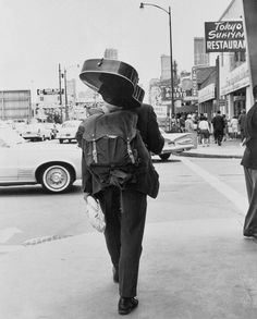 Carrying a loaf of bread, a guitar and a knapsack, a hippie walks down the street away from the Haight-Ashbury district of San Francisco, Oct. 16, 1967.  As the last of the summer weather moves out, so does the influx of young people that came in with it.  (AP Photo) Photo: Jb, AP