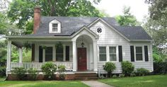 Quaint entry & porch - great curb appeal. Design inspiration image.