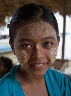 I met this girl was on the way from Mandalay to the ancient capital of Ava on the banks of the Irrawaddy River. The thanaka paste, made from a special tree, is used as traditional make-up and for protection from the sun. Her leaf designs were most artistic and complemented her natural good looks.