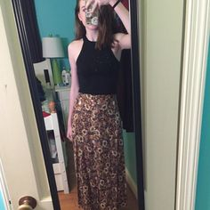 Floral maxi skirt with buttons Floral maxi skirt size small. Has buttons up the front on half of the skirt and slightly elastic in back. Great condition and light enough for summer. Very 90s. Brandy for views Brandy Melville Skirts Maxi