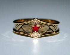 Custom gold plated surgical steel Wonder Woman by Batjeepster