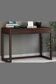 One of the modest and elegant designs of the study table. It renders a comfortable look with the footrest at the bottom and is made up of the finest quality Sheesham wood. #studytable #furniture #moderndesign #workspace