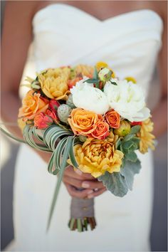 Orange & Coral hued wedding bouquet with grassy greens & succulents