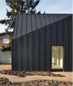 A black house interferes between the trees and the riverBlack house in Belgium WHAT IS ROOF CLADDING? Rooftop cladding includes the use of a waterproof layer which is basically introduced to anticipate damp. Zinc Cladding, Roof Cladding, House Cladding, Exterior Cladding, House Facades, Facade House, Architecture Classique, Architecture Résidentielle, Classical Architecture