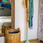 Wood clothes rack, practical and stable. The combination of raw wood, natural branches and a touch of modern paint, provide a contemporary design element to the living space.