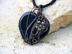 Dark blue gemstone heart wire wrapped pendant by IanirasArtifacts