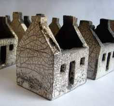 Ceramic houses, glazed and raku fired. Inspired by the abandoned dwellings on the islands of St. by rowena brown