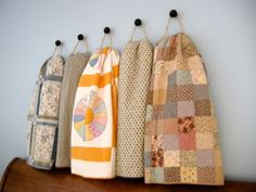 Simple quilt hangers out of rope and knob.  Inspired by a Pottery Barn store display and explained at Me&My Sister Designs