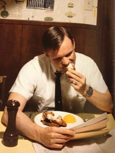 Neil Armstrong eating his last breakfast on Earth before leaving for the moon.