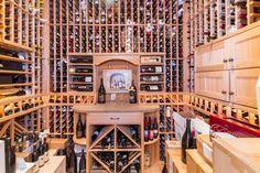 Craftsman Wine Cellar with Hardwood floors, Built-in bookshelf, High ceiling