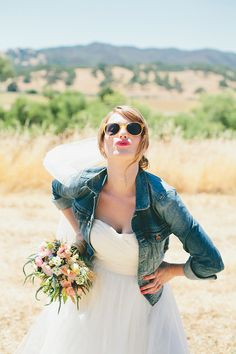 Bride with a denim jacket. So chic for a fall wedding! | http://www.weddingpartyapp.com/blog/2014/09/18/6-awesome-coverups-for-fall-brides-stay-stylish-warm/