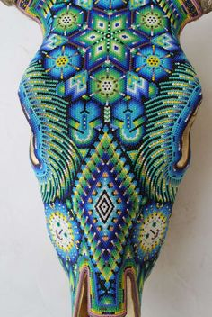 Beautiful Huichol Indian Beaded Cow Skull | From a unique collection of antique and modern sculptures at http://www.1stdibs.com/furniture/more-furniture-collectibles/sculptures/