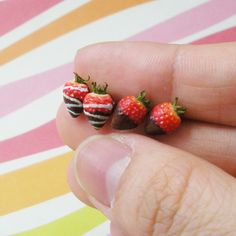 These amazingly life-like strawberries are actually stud earrings made by Petite Creations, they have a shop on Etsy. The scale is much larger than 1:12 but they are probably the best polymer clay strawberries I have ever seen.