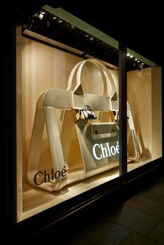 Retail window display with huge purse; Window Display Design, Shop Window Displays, Store Displays, Visual Merchandising Displays, Visual Display, Retail Windows, Store Windows, Boutiques, Vitrine Design