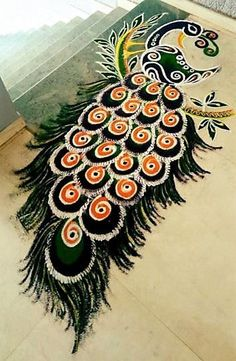 Peacock Rangoli Art Designs Check out these gorgeous rangoli art designs. They are the fresh new ones that are perfect for most Indian festivals and other special occasions. Rangoli Designs Peacock, Easy Rangoli Designs Diwali, Indian Rangoli Designs, Rangoli Designs Latest, Simple Rangoli Designs Images, Free Hand Rangoli Design, Rangoli Border Designs, Small Rangoli Design, Rangoli Patterns